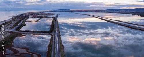 vue aérienne au dessus d'une route entre mer et étang  - 231763762