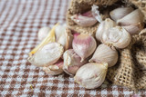 Burlap sack with garlic - 231778382