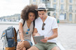 view of a young couple on holidays using a tablet