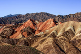 Zhangye Danxia National Geopark - Gansu Province, China. Chinese Danxia multicolor danxia landform, rainbow hills, rainbow mountains, sandstone erosion, layers of Red, Yellow and Orange stripes. - 231796595