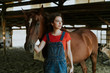 Leinwandbild Motiv Portrait of a girl and a horse