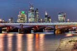 Blackfriars Bridge and the skyscrapers of the City of London at night