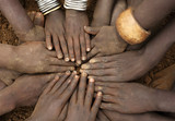 African ceremony of the Mursi tribe, close-up of hands of a group of children, Ethiopia