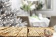 Leinwanddruck Bild - Old wooden table in. Christmas evening and magical time