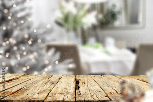 Leinwanddruck Bild Old wooden table in. Christmas evening and magical time