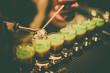 Leinwandbild Motiv Barman mixing some shots