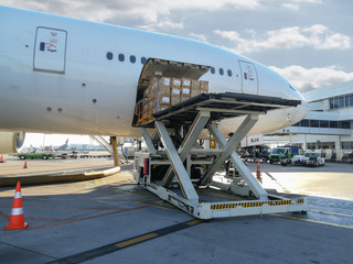 Process of cargo handling. Parcels loading with high loader at Airport.