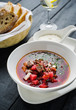 Homemade borsch with meat and sour cream.