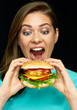 Woman eat burger. Close up face portrait