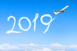 Leinwanddruck Bild - Happy New year 2019 concept. Drawing by airplane vapor contrail in sky.