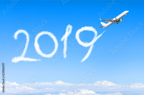 Leinwanddruck Bild Happy New year 2019 concept. Drawing by airplane vapor contrail in sky.