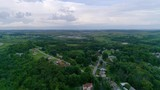 Drone Flight over Midway, Pennsylvania with storm clouds in the distance. - 231872335