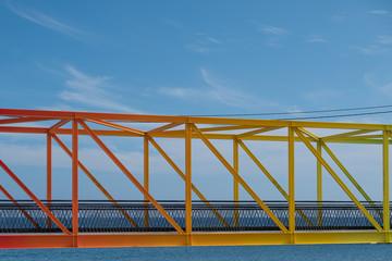 rainbow colored bridge with ocean background - colorful steel bridge   © hanohiki