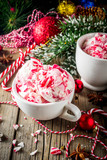 Christmas dessert, Homemade Peppermint Candy Cane Ice Cream in two cups, old wooden background with xmas decorations copy space - 231885986