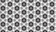 Black and white abstract flowers vector pattern