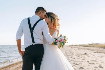 bride and groom on the seashore. wedding concept on the sea, on a fabulous island.