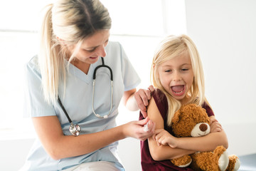 A cute Child Patient Visiting Doctor's Office