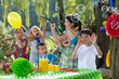 Quadro Happy children have fun during birthday party with soap bubbles and balloons in the garden