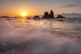 beautiful Benijo beach in Tenerife, waves crashing against boulders during sunset - 231911116