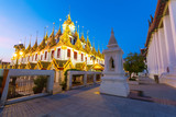 Loha Prasat in Wat Ratchanatdaram at dusk in Bangkok, Thailand. - 231911929
