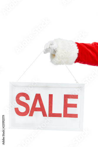 Leinwanddruck Bild cropped view of santa claus holding discount board with sale sign isolated on white