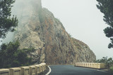 empty road in thick fog in mountain landscape - - 231916576
