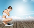 Leinwanddruck Bild - Young  woman standing on scales, fitness concept