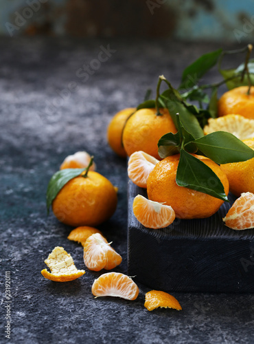 ripe organic tangerines with green leaves - 231920111