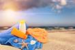 Close-up of beach accessories . Flip-flops, oil,