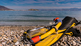 Flippers and snorkeling tube on sea shore - 231921713