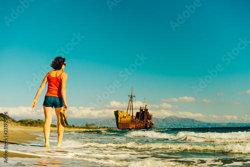 Foto Murales Tourist woman on beach enjoying vacation