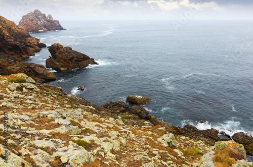 Foto Murales Cliffs at ocean  coast  in  cloudy day