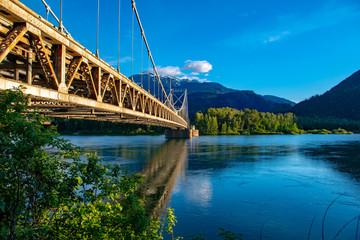 Suspension bridge in mountains © Garry
