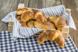 Boxes with poppy seed croissant on white-blue clothtable - 231935358