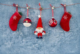 Christmas background. Red Christmas decoration with Santa Claus on blue background. Copy space.