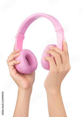 Hand holding Pink Headphones Isolated on White Background - 231949311