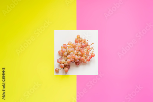 top view of flat lay of bunch of grapes on double color sirface background f - 231950545