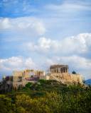 Greece, Acropolis of Athens under blue cloudy sky, view from Pnyx hill