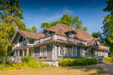 Historic manor house situated in Palace Park dating from 1845, the oldest building in Bialowieza town, Poland. - 231960386