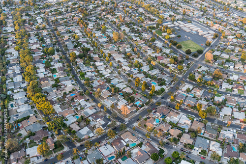 Late afternoon aerial view of houses and streets in the San Fernando Valley region of Los Angeles, California.