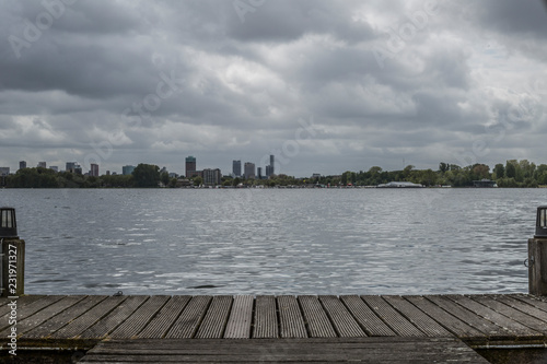 Acrylglas Pier amazing view city of rotterdam from a jetty with a lake in the on a wonderful cloudy and gray day in the Netherlands Holland, copy space or space for text