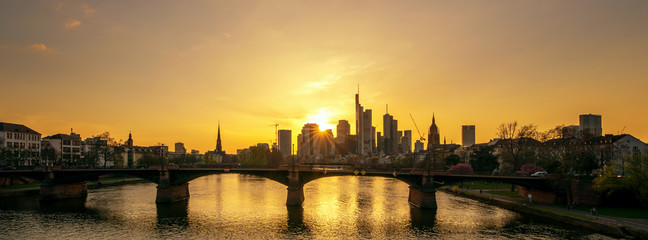 The skyline of the banking metropolis in Frankfurt am Main during a beautiful sunset. Concept: travel or landscapes © andre