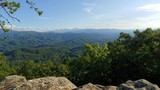 A view of the Great Smoky Mountains National Park filmed on a rock cliff in the Foothills Parkway located in the Smoky Mountains - 231980356