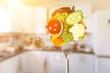 Leinwanddruck Bild - Fresh variety vegetables on fork, soft blue background