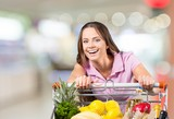 Young woman shopping in grocery store with shopping cart - 231989556