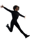 one mixed race african young teenager girl woman jumping happy in studio shadow silhouette isolated on white background - 231994771