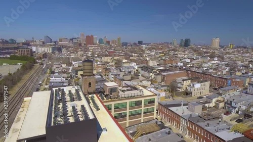 Wall mural Drone flight over urban cityscape.