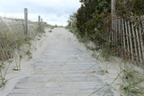 Wooden slat and sandy boardwalk leading to the beach on Long Beach Island in New Jersey - 232002953