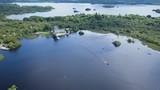 Moving Aerial video over large beautiful lake,with small pleasure boats leaving an old castle by the shoreline.Location Ross Castle, lakes of Killarney,Ireland - 232003558