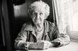 Monochrome portrait of an elderly woman.